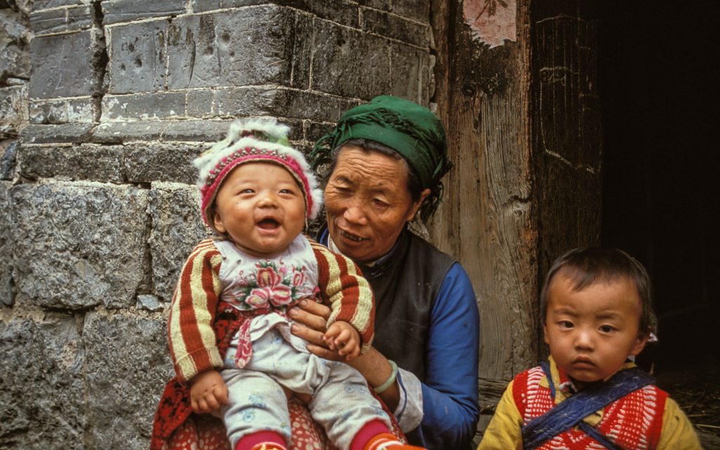 Happy tribal baby in Lijiang