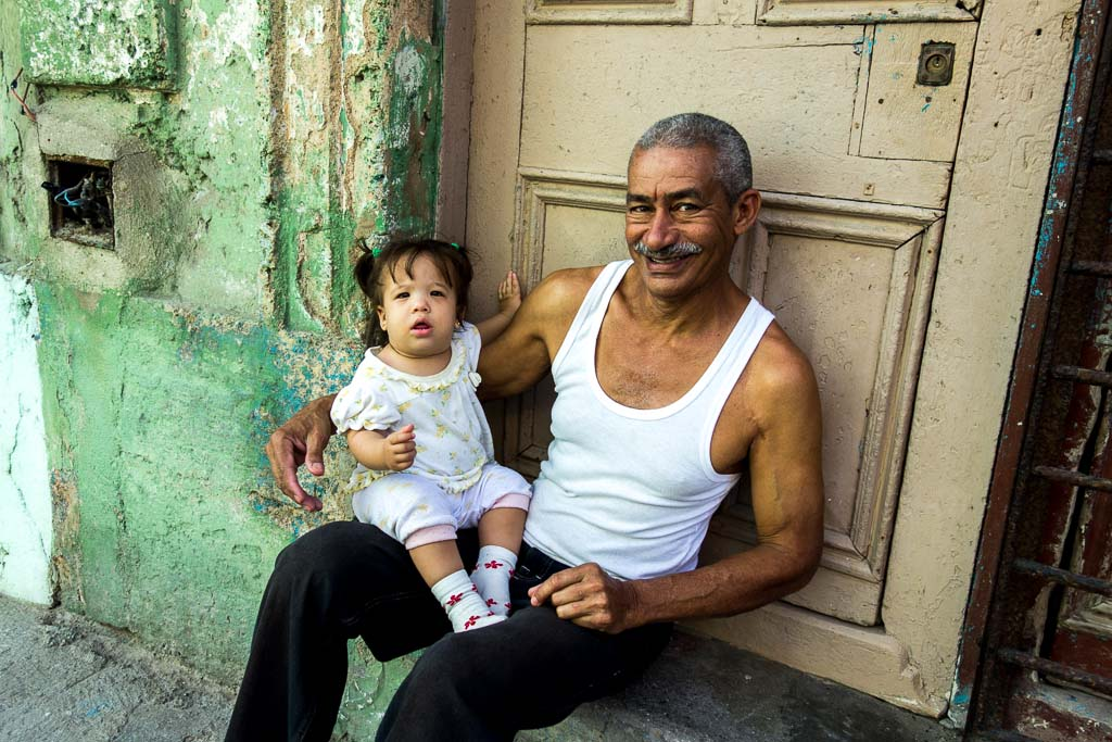 Man holding baby daughter Havana Cuba portrait
