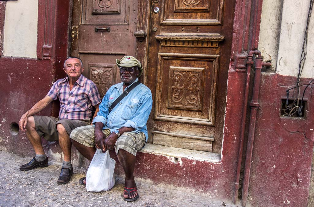 Two men waiting in street Centro Cuba
