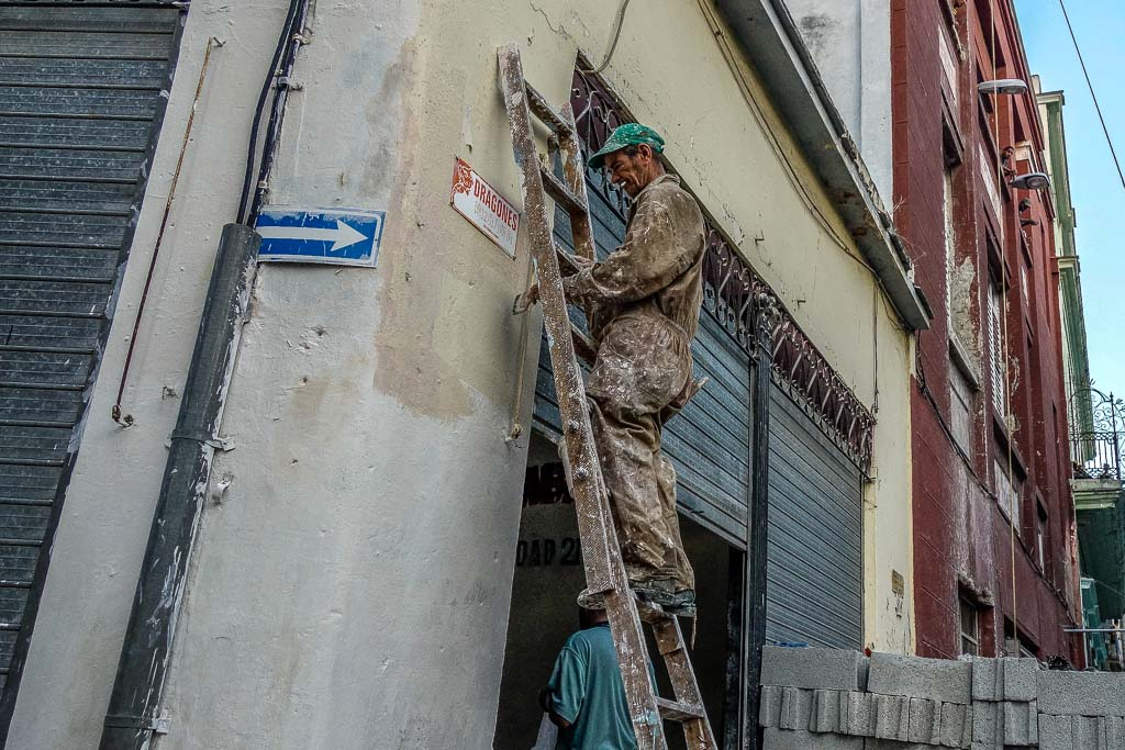 Painter working on building Centro Cuba