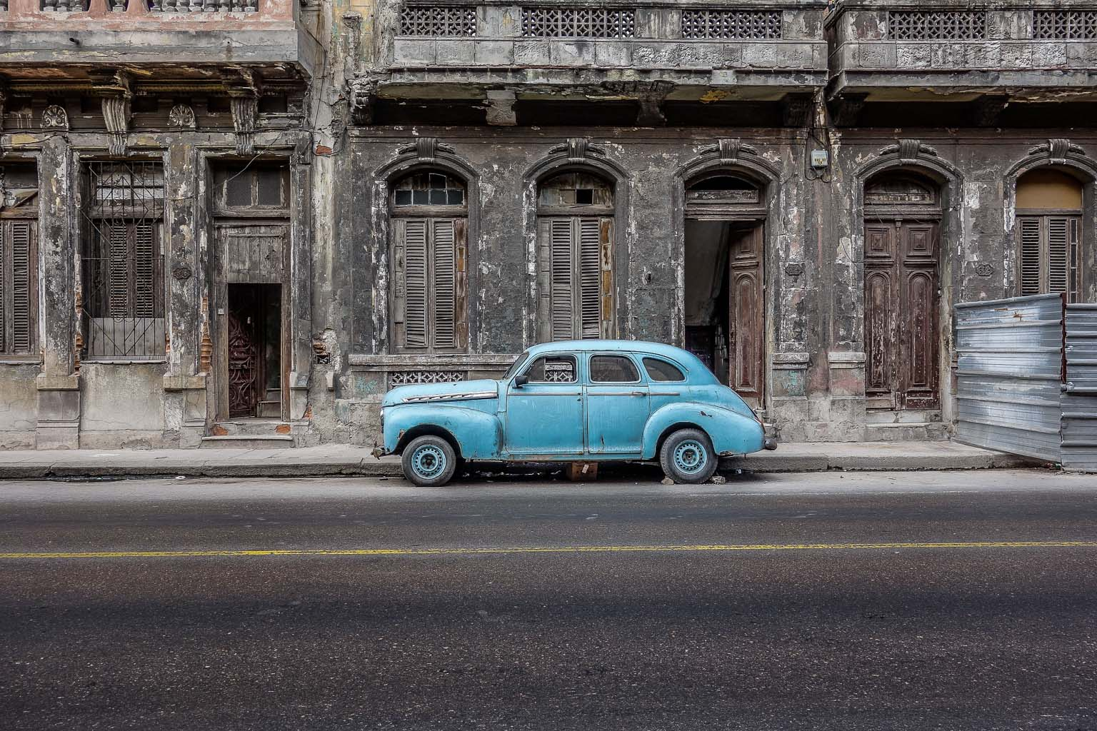 Blue car on Calle Neptuno Havana Cuba