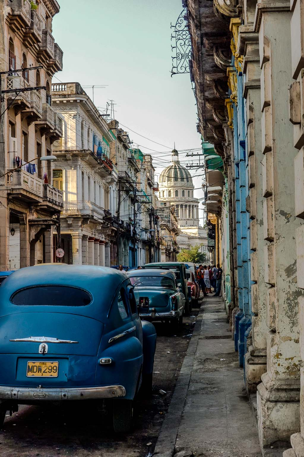 Old parked cars near Capital building Havana Cuba