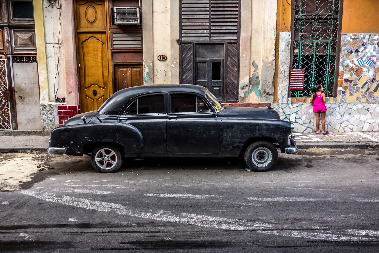 Black car on Calle Neptuno Havana Cuba